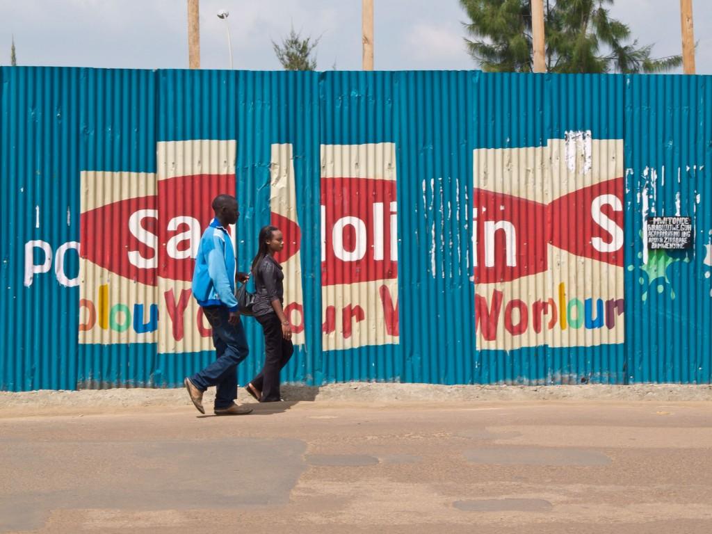 Advertising on construction hoarding, Kigali. Rwanda 2011