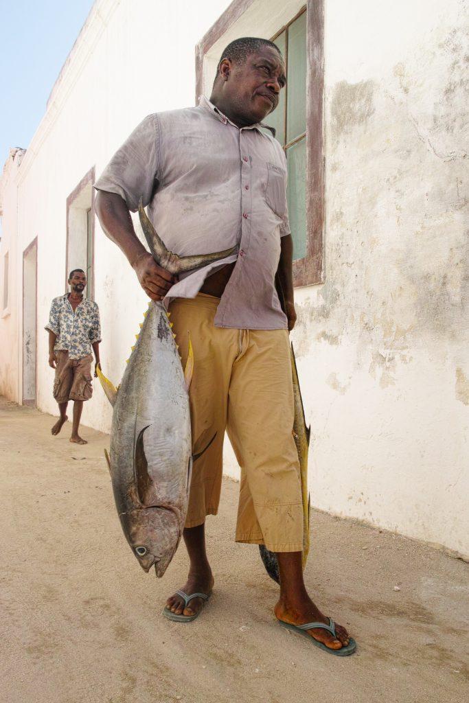 City of Ilha de Mozambique, man with a yellowfin tuna