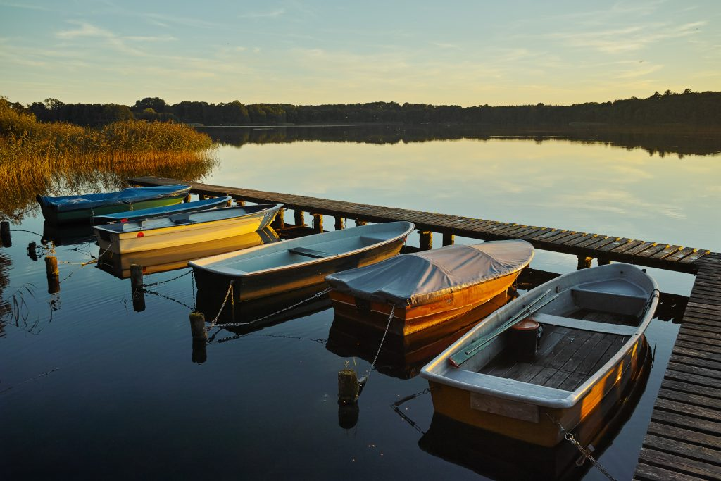 Boats at sunset at the Schaalsee in September