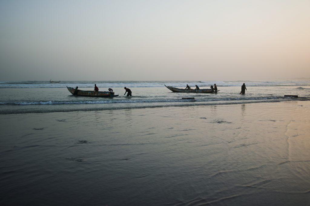 Launching boats at the beach in Yoff, Dakar